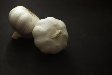 Garlic on black background