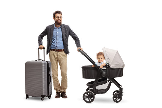Father with a suitcase and his baby son in a stroller