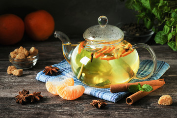 Tangerine tea with orange zest on a rustic wooden table