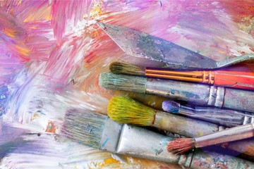 Artist paint brushes and paint cans of