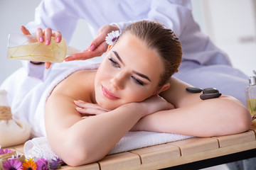 Woman during massage session in spa
