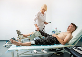 Patient on CPM (continuous passive range of motion) machines.