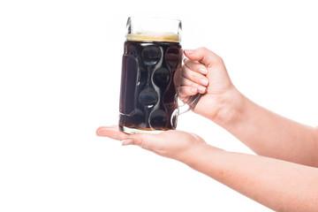 cropped image of woman holding mug of dark beer isolated on white background