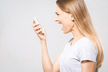 Angry beautiful woman boss shouting with phone. Isolated portrait on white background. Isolated.