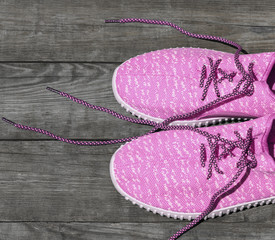 pink textile shoes with untied laces