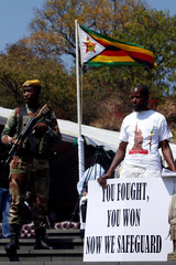 A supporter of  Zimbabwe's President Elect Emmerson Mnangagwa holds a poster during the national 38th Heroes Day Commemorations at the Heroes Acre in Harare