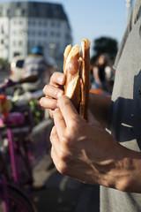 man eating a german ham sandwich