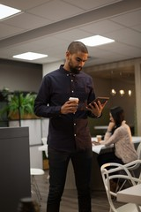 Male executive using digital tablet