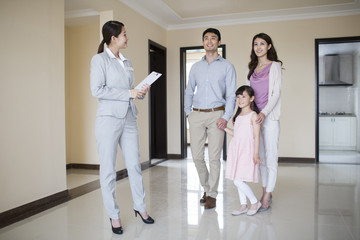 Realtor showing new house to young family