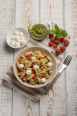 cold pasta salad with mozzarella and pesto sauce