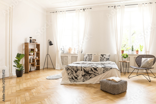 Marvelous A Big Bed With Linen A Metal And Rattan Chair A Lamp A Caraccident5 Cool Chair Designs And Ideas Caraccident5Info