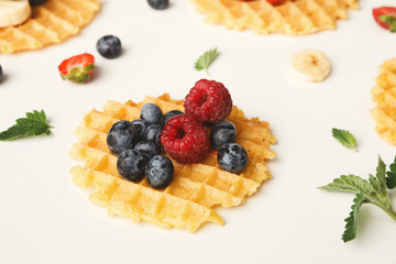 Round waffles with fruits, healthy breakfast background