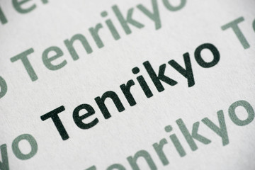 word Tenrikyo printed on paper macro