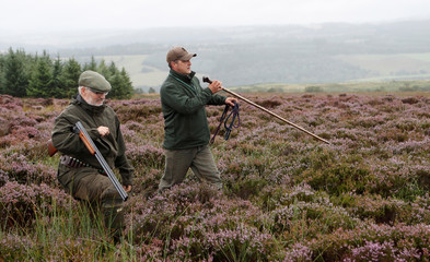 Members of a shooting party on Forneth Moor prepare to set off on the opening day of the grouse shooting season, Scotland