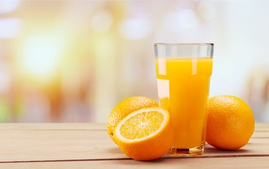 Orange Juice in glass on background