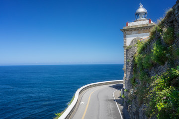 The road to the sea and lighthouse. Asturias. Spain.