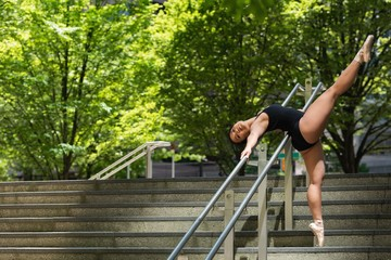 Female ballet dancer dancing on the steps