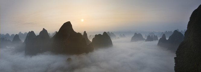 Chinese mountains in the mist sunrise