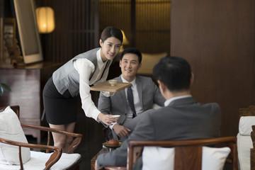Cheerful businessmen talking in tea room