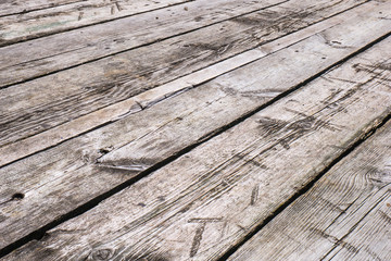 White boardwalk of stripped weathered washed out wooden planks with scratches. Abstract natural texture background
