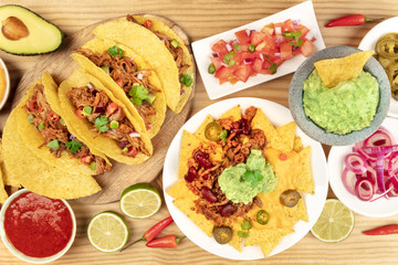 Overhead photo of an assortment of various Mexican dishes