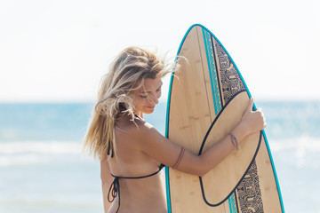 A Woman Surfer Standing at Beach