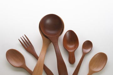 Set of wooden spoons on white background