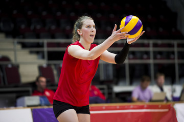 Volleyball player serving the ball.