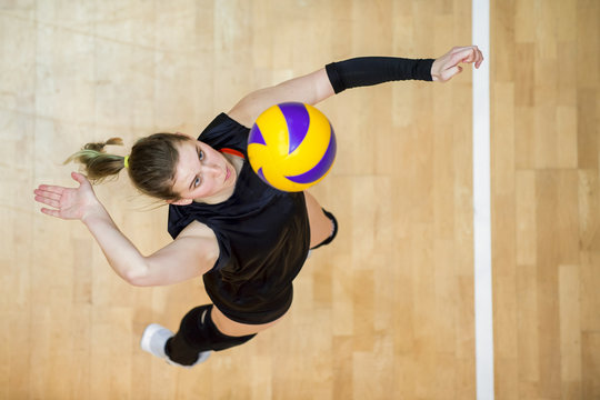 Upper View of Female Volleyball Player at Service