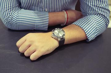 Big diver's watch on man's wrist
