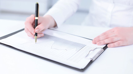 business woman analyzing in the financial schedule