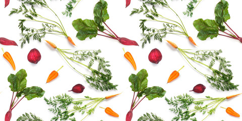 Fototapete - Seamless pattern of fresh carrots with green tops and beetroot with leaves isolated on white background, top view. Creative food background.