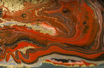 Gold marbling texture design. Red and golden marble pattern. Fluid art.