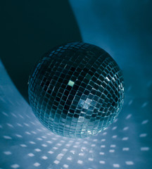 mirror ball.isolated on a dark background with blue backlight