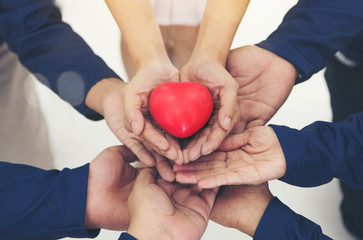 red heart on hands together collaborate of teamwork