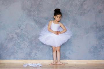 Little girl ballerina in a white tutu