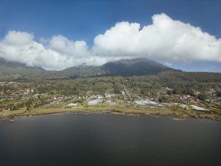 Aerial view of river by landscape against cloudy sky