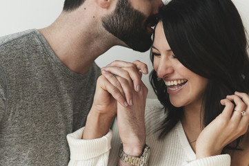 Close-up of romantic couple holding hands while standing at home