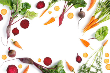 Fototapete - Vegetable frame. Creative flat layout of vegetables: carrots and beets, isolated on white background, top view.