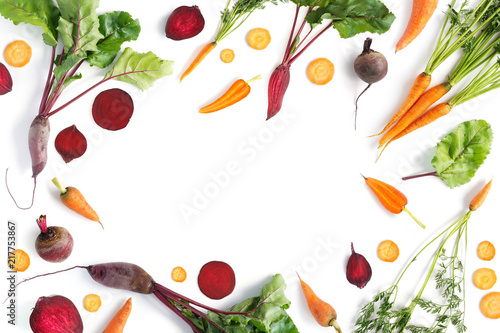 Fototapete Vegetable frame. Creative flat layout of vegetables: carrots and beets, isolated on white background, top view.