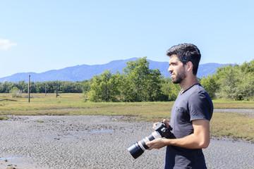 man photographer observing nature