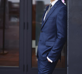 stylish groom posing