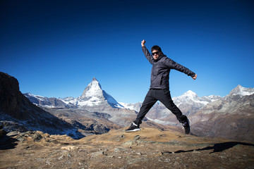 asian tourist jump with happy and relax moment with Matterhorn m