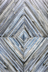 A diamond-shaped pattern of the old wooden boards, grey blue background texture