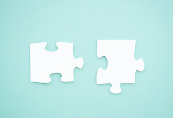 Puzzle pieces on blue background. Autism awareness day.