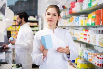 Woman pharmacist standing in drugstore