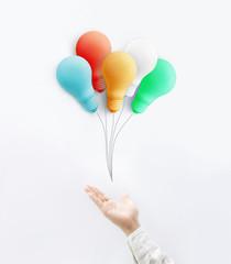 Businessman with colorful balloon light bulb.business creativity idea