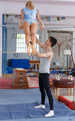 Man and woman training on sports equipment