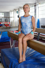 Woman doing exercises on balance beam