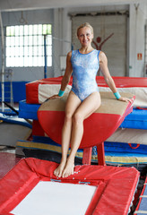 Woman vaulting on trampoline